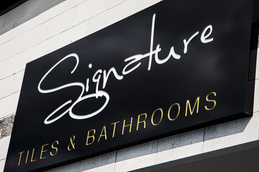 A picture of the signature tiles shop sign